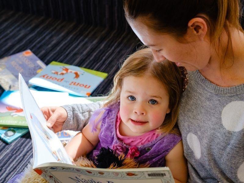 mum and toddler reading