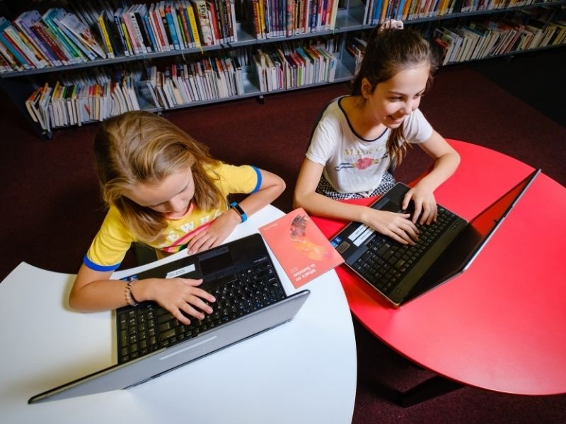 two children at computers